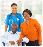 caregiver with old couple smiling