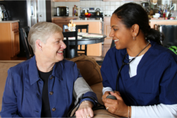 caregiver taking patient's blood pressure