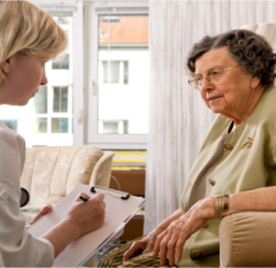 caregiver doing speech therapy with elderly patient